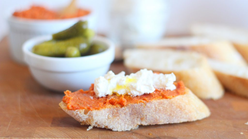 prosciutto spread on a piece of crusty bread