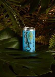 A marketing campaign showing a can of Outlandish CBD seltzer in a jungle setting