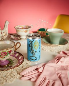 A marketing campaign showing a can of Outlandish CBD seltzer on a grandma's table